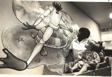 nurse-shows-young-patient-willis-knighton-frog-mural